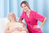 Physiotherapist and elderly patient — Stock Photo