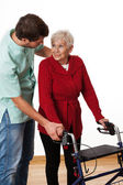Physiotherapist teaching using the walker — Stock Photo