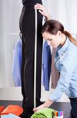 Tailor measuring pant suit — Stock Photo