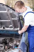 Mechanic raising up car hood — Stock Photo