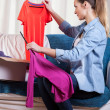 Woman packing clothes — Stock Photo #45244493