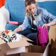 Постер, плакат: Woman packing stuff