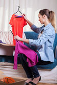 Woman packing clothes — Stock Photo