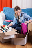 Woman packing stuff — Stock Photo