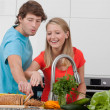 Happy couple in kitchen — Stock Photo #45319291