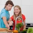 Happy couple in kitchen — Stock Photo