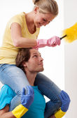 Piggy back dusting — Stock Photo