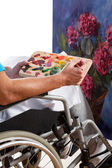 Disabled man painting picture — Stock Photo