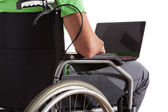 Paralyzed teenager with laptop — Stock Photo