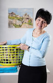 Woman with a basket of clothes — Stock Photo