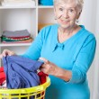 Elderly woman sorting laundry — Stock Photo #45717059
