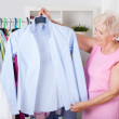 Elderly woman choosing an outfit — Stock Photo #45718297