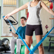 Man and woman doing exercise — Stock Photo