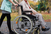 Lady on wheelchair and nurse — Foto de Stock