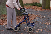 Disabled walking with walker outdoors — Foto de Stock