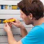 Handyman checking voltage — Stock Photo