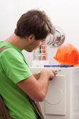Handyman repairing central heating — Stock Photo