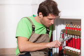 Repairman fixing valves in home — Stock Photo