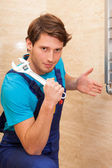 Strong handyman repairing radiator — Stock Photo