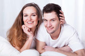 Happy couple in bed — Stock Photo