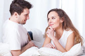 A couple contemplating in bed — Stock Photo