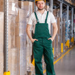 Warehouseman standing in storage — Stock Photo