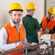 Production workers during production process — Stock Photo #46146603