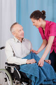 Nurse caring about disabled man — Stockfoto
