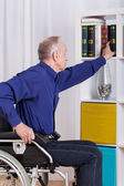 Disabled man during everyday activities — Stockfoto