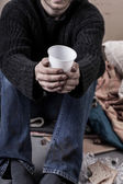 Homeless man waiting for alms — Stock Photo