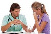 Doctor comforting patient — Stock Photo