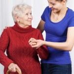 Girl helping senior woman — Stock Photo #46513731
