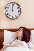 Woman looking at clock — Stock Photo