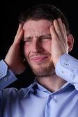 Podnikatel, trpí bolestmi hlavy — Stock fotografie