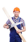 Carpenter holding plank and saw — Stock Photo