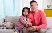 Asian siblings with puppets — Stock Photo