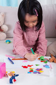 Little kid painting a picture — Stock Photo