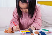 Girl drawing a picture — Stock Photo