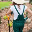 Woman after digging flowerbeds — Stock Photo #46631135