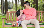 Asian family sitting — Stock Photo