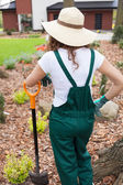 Woman after digging flowerbeds — Stock Photo