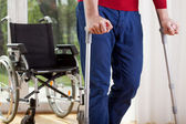 Disabled man on crutches — Stockfoto