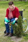 Disabled working in a garden — Stockfoto