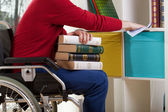 Disabled man during cleaning furniture — Stockfoto