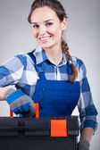Handywoman with a toolbox — Stockfoto