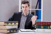 Businessman by a boss's desk — Stock Photo