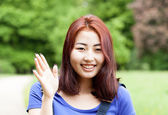 Smiling mongolian girl in a park — Stock Photo