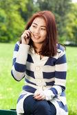 Mongolian lady talking on phone — Stock Photo