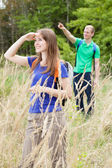 Couple on the meadow looking at the sky — Stock Photo