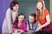 Students and teacher at chemistry lesson — Stock Photo